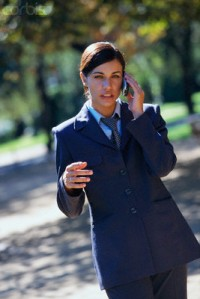 Businesswoman Using Cellular Phone Outdoors